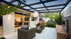 Contemporary Patio by Ventura Homes -Pergola made from Colorblind and a black wood frame. Patio Pergola, Pergola Canopy, Wooden Pergola, Pergola Shade, Patio Roof, Patio Wall, Flagstone Patio, Cheap Pergola, Backyard Patio