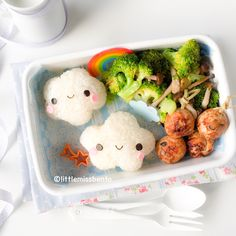 bento box with clouds made with plastic wrap for shape and eyes/cheeks seaweed and egg sheet