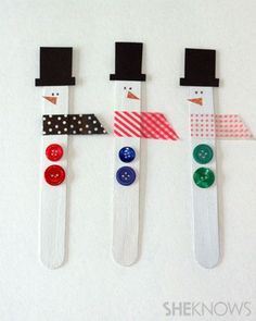 Too cute ... a painted popsicle stick, washi tape, buttons, felt hat and paper nose. Could hang with string or put magnet on back.