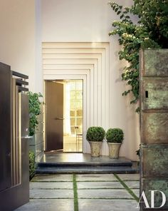 A stepped door surround at the front entrance | archdigest.com