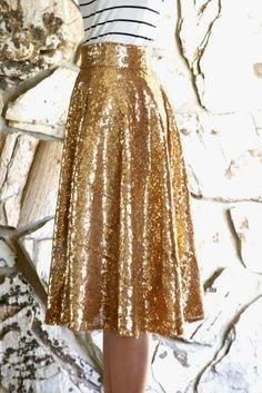 I wanted a gold sequin midi skirt and searched online for one but couldn't find one I loved.  This fabric I used is between a gold and a rose gold, it's a beautiful rich gold tone, darker than champagne and I personally like it much better than just gold or champagne gold, it looks more …