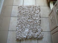 DIY bathroom rug made out of old towels! so easy!