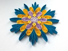 Snowflake Blue Yellow Purple, Quilled Handmade Art, Paper Quilling, Home Decoration Idea, Christmas Tree Decor, Winter Ornaments. You can hang it on Christmas tree, use as fridge magnet, decorate Your bookshelf, dinner table or put it in lovely frame. Also can make an excellent addition to Christmas presents! Dimensions - 4 ″ x 4 ″ (10 cm x 10 cm) - a nickel (5 cent coin) for scale. Made from 1/4 ″ (5 mm) paper strips of 90 g/m2 paper.