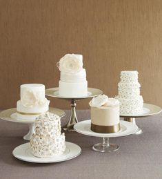 Have individual or mini-cakes served to guests as you would any other course. Or display a large table of them stacked to look like one big cake, and then invite guests to help themselves. | via The Knot