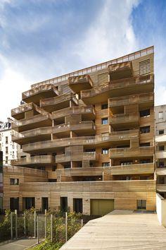 Wood facade towards garden  Grenelle, 35 Logements / Peripheriques Architectes