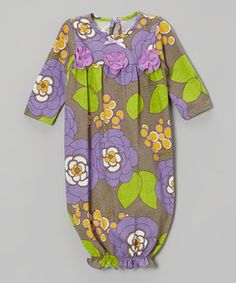 Cute as a button and bright to boot, this comfy, cotton-blend gown flourishes with its dreamy floral designs and matching blossom appliqués. Plus, the stretchy elastic hem allows little legs to move freely.