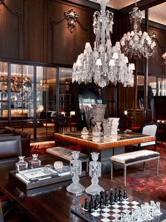 Baccarat Hotel NYC - The Grand Salon rounds out the common area, complete with coyote-skin armchairs, pleated silk-covered walls, and a variety of French pastries laid out across a central marble table in the mornings.