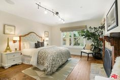 Keep warm in hot LA! The home also features five fireplaces located throughout the house