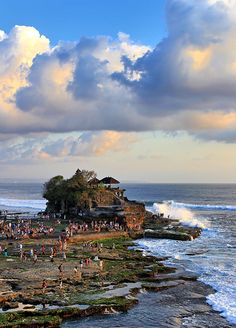 Tanah Lot is 1 of most popular tourist spots in Bali and I guess for good reasons. It used to be free to enter the area but like anything else in Bali nowadays, a fee is required. People usually come here to shoot wedding photos and looking at the massive Temple Bali, Hindu Temple, Gili Island, Best Sunset, Tourist Spots, Lombok, Bali Travel, Island Life, Vacation Trips