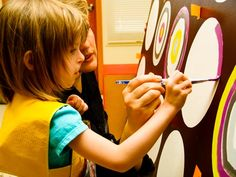pre-painted canvas with circles blocked off, then let each child have a turn painting concentric circles (Woodinville Montessori School Auction  March 2009    Kathy was invited to work with the Oak Class on an art project that was auctioned off to help support this fabulous school. She found inspiration while working with all of the young artists!)