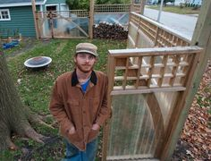 Champaign resident Eric Burton with the fence that he and his domestic partner, Martha Mills, built using treated lumber and fiberglass corrugated panels. (a href=http://news-gazette.mycapture.com/mycapture/remoteimage.asp?image=http://assets.news-gazette.com/sites/all/files/images/2011/11/19/20111209-095904-pic-978547568.jpgPurchase a Print/a | a href=/image/2011-12-11/20111209-095904-pic-978547568jpg.htmlMore/a)