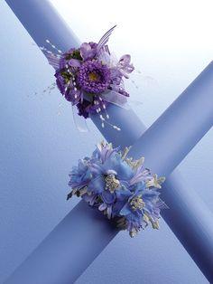 Purple Matsumotto wrist corsage (upper) Lavender & blue delphinium wrist corsage (bottom)Purple Matsumotto wrist corsage (upper) Lavender & blue delphinium wrist corsage (bottom)
