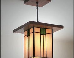Building time is 3-4 weeks. Shipping is free and 1-5 days with FedEx Ground depending on your location from Southern California. If you need the item sooner contact us for availability.  Handmade in the U.S.A. Mission Style Chandelier - Light Fixture by Mission Studio  Wood: Quartersawn White Oak Frame Size: Regular 21 x 17 Ceiling Board Size: Regular 12 x 8 Weight: 18LB Bulbs and Watts: 4 light bulbs maximum watts 60 each Rating: UL Listed for Dry Locations Glass: Hand rolled stain glass…
