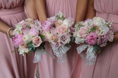 Peonies, English Garden Roses, Lily of the Valley and Astrantia they were finished with lace bows and handles
