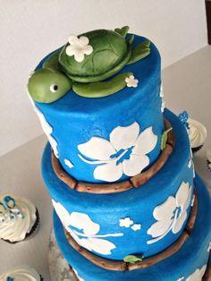 Luau cake blue buttercream with white fondant flowers and fondant turtle