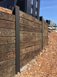 Wall of Used oak Railway sleepers slotted into RSJs