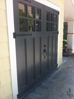 Enemies of carriage doors. Articles about custom swing out carriage house garage doors. Evergreen Carriage Doors builds custom hand crafted authentic antique carriage house doors and carriage garage doors. Carriage Style Garage Doors, Black Garage Doors, Carriage Doors, Painted Garage Doors, Swing Out Garage Doors, Small Garage Door, Side Hinged Garage Doors, Unique Garage Doors, Garage Door Hinges