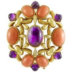 1970s Cartier Paris Coral Amethyst Gold Brooch    Distinctly retro 1970's Cartier brooch, mounted in openwork 18k Gold and combining bright pink cabochon Corals with vivid purple cabochon Amethysts.   The brooch measures 2 1/2 inches long and has a foldable loop at the rear, to also be worn as a pendant Signed Cartier Paris, and numbered.