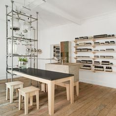 A contraption assembled from glass beakers and steel tubes dispenses scent into this outpost of skincare brand Aesop above a record store in Nottingham, UK