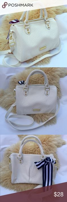 SALE! White Steve Madden handbag with strap Cute Steve Madden Handbag with removable strap. Gold zippers and pink interior. Extra strap and striped bow included. Some blue color on small strap from wearing with a jean shirt. Steve Madden Bags Shoulder Bags