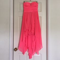 Bright Coral High Low Prom Dress Gorgeous bright coral/pink high low prom dress from Arden B💕 wore this dress once to prom a few years ago! The dress is in great condition, there are some marks under the arms (seen in picture) from being stored, but they are not noticeable when worn since they are under the arms. Love this dress but I don't need it anymore! Arden B Dresses Prom