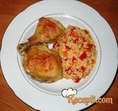 Recept za Cous-cous sa piletinom. Za spremanje ovog jela neophodno je pripremiti piletinu, papriku, luk, šargarepu, cous, puter, so, biber,začin.