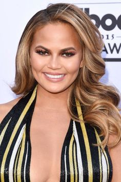 You Have To See Chrissy Teigen's Beauty Evolution #refinery29  http://www.refinery29.com/2016/04/107440/chrissy-teigen-beauty#slide-15  Notice the monochromatic color story in Teigen's look for the 2015 Billboard Music Awards: Copper shadow and a brown-based nude lip reflect the deeper tones in her cascading curls....