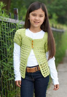 This crocheted cardigan is a great transitional layer. Little girls can wear it as a stylish topper during the summer months and over a long-sleeved tee during the fall! Shown in Patons Classic Wool DK Superwash.