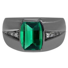 Custom Made Men's Barrel Emerald Diamond Ring In Black Rhodium Plated White Gold Gemologica.com offers a unique selection of mens gemstone and birthstone rings crafted in sterling silver and 10K, 14K and 18K yellow, white and rose gold. We have cool styles including wedding and engagement rings, fashion rings, designer rings, simple stone and promise rings. Our complete jewelry collection of gemstone rings for men can be seen here: www.gemologica.com/mens-gemstone-rings-c-28_46_64.html