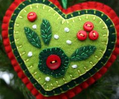 Christmas heart ornament. Red & Green felt, buttons, applique. $11.50, via Etsy. These colors are stunning together!