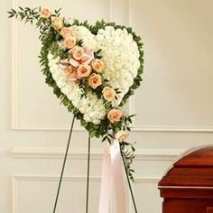 Show your love with a flower delivery to a funeral home. This White Flower Standing Heart With Peach Roses is created with fresh flowers. White Carnation, White Roses, White Flowers, Flowers For You, Types Of Flowers, Funeral Floral Arrangements, Flower Arrangements, Funeral Sprays, Cemetery Flowers