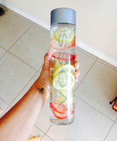 Voss sparkling detox water. Lemons, strawberries and pineapple. Add as much fruit you like and let it sit over night in the refrigerator.