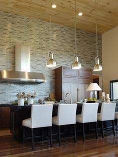 Tile to the ceiling? Lamp on the counter?  Beautiful, natural wood plank ceiling?  Heaven.