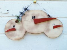 Hanging Wood Snowmen Faces Sign, Primitive Snowmen, Handmade, Handpainted with Orange Carrot Noses, Painted Eyes. $22.00, via Etsy.