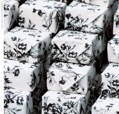 Wedding favours are the perfect way to take the black and white theme through to your reception. Decorate boxes with monochrome paper and fill with whatever gifts you wish.