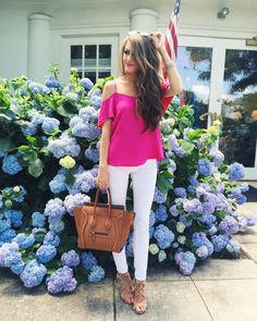 hot pink cold shoulder top + white pants + neutral bag and shoes