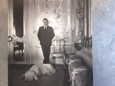 British M.P. Chips Channon poses in his famous Bavarian Rococo dining room, which was decorated in the 1930s by Stéphane Boudin of Jansen.