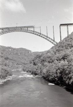 While the bridge was being built, finished in 1977. Prior to the opening of the bridge the only way across the river was the Fayette Station Road.  The narrow road wound around the mountain curves, across a one-car bridge and back up the other side.