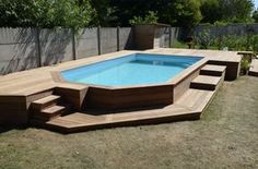 Piscine hors sol Wooden terrace around a swimming pool How Do We Know What Time It Really Is? Above Ground Pool Landscaping, Small Backyard Pools, Backyard Pool Landscaping, Backyard Pool Designs, Backyard Projects, Best Above Ground Pool, In Ground Pools, Swimming Pools Backyard, Swimming Pool Designs