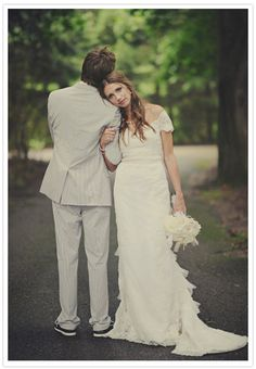 kind of like the idea--though not having the grooms face show is kinda odd (unless it is a before wed shot)