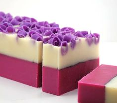 Bold colors make for striking soaps. Shavings incorporated into the top layer add more interest.