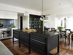 """Walls were shifted in the kitchen to accommodate a cool room, walk-in pantry and a glass-fronted storage wall, the only structural changes in the house. When they selected the colour of the classic marble for the benchtop, designer Sarah Davidson told the owner it's either """"the little black dress or the little white dress, both are timeless"""". The owner chose the black, echoed in the splashback and behind the china cabinet, """"so it's not a flat wall, to give it life and make it inclusive and…"""