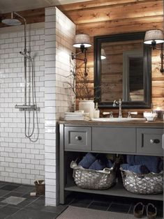 To bath, sink on one side, whole floor and half wall tiles, small curb to separate shower but open other wise, maybe a weighted shower curtain, can find or use old furniture