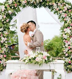 Michelle and Danh celebrate their marriage with a kiss at @Four Seasons Resorts Bali.