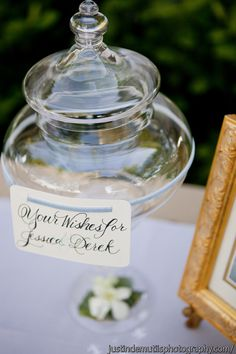 Well wishes jar is a great new idea instead of using a boring guest book.  Your guests can get creative with their message, even add a favorite memory.  Wedding moment!!