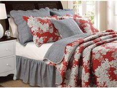 """Everly Quilt Set-Update your bedroom decor with our Everly quilt set. Festooned with flower blossoms outlined in black on a rich red ground, the Everly quilt and shams add energy and style to any living space. Reverses to a coordinating black-and-white gingham check for a look that is both modern and retro.Dimensions:King Set: 105 x 95"""" (Includes two king shams)Full/Queen Set 90 x 90""""   (Includes two shams)Twin Set 68 x 88""""(Includes one sham)."""