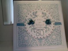 80th Birthday: I was asked to make an 80th birthday card for a colleagues mum.  I used spellbinders corners to make the lacy doily look, Grand circles and the leaves