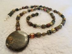 Pond Creatures Fish and Frog Brown Stone by OnPurposeArtifacts