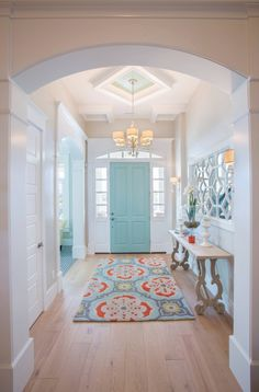 We all know painting the exterior of a home's front door a distinctive color is one of the fastest ways to add character and enhance curb appeal. But what about the interior of your front door? Consider extending the exterior door color inside — or select another hue that both coordinates with the exterior while setting the design tone for the entry.