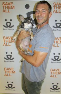 Brandon McMillan at Best Friends Animal Society Adoption Center with Thomas the dog